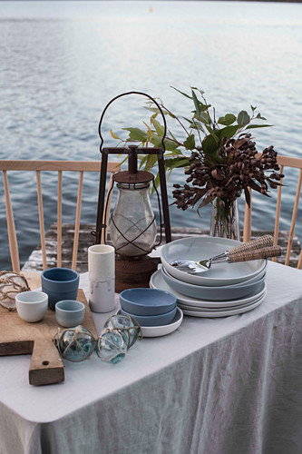 Maritime table on a jetty on a lake
