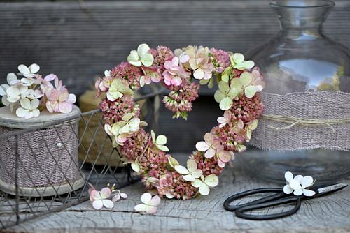 Heart-shaped wreath of sedum and hydrangea florets