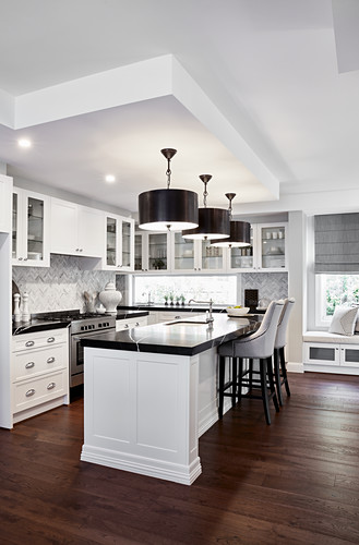 Counter with black worksurface in open-plan kitchen