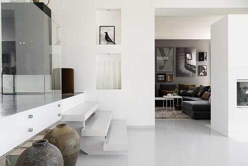 White steps leading to raised level in elegant, open-plan interior