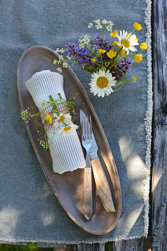 Posy of wildflowers and napkin decorated with flowers