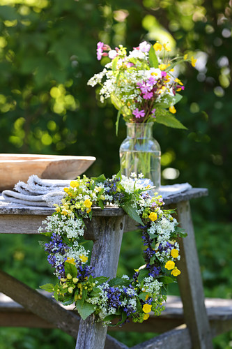 Vase of wildflowers and pretty wildflower wreath