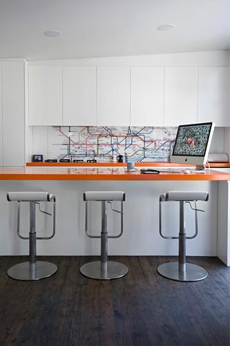 Modern kitchen with map of underground as splashback