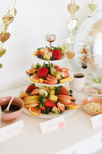 Fresh fruits on cake stand on party buffet table