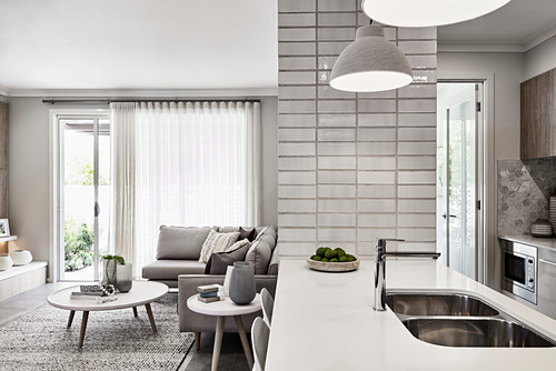 Open-plan kitchen in interior in shades of grey and white