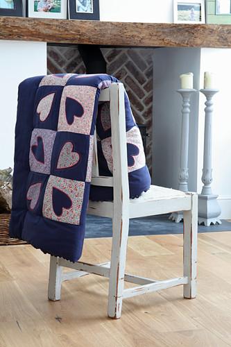 DIY patchwork quilt with heart motif