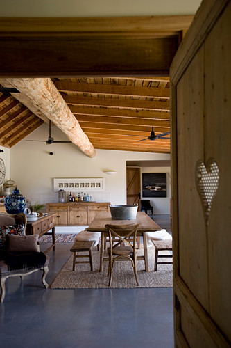 View into rustic dining room with wooden furniture