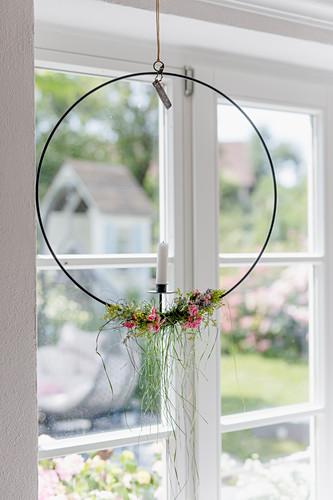 Nordic flower wreath hung in window