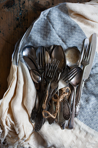 Vintage cutlery on tea towel