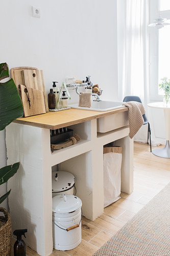 DIY sink unit in small kitchen-dining room in natural shades