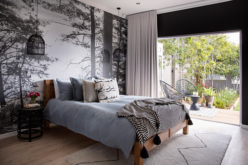 Photo mural with woodland motif in bedroom with access to gaarden