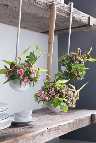 Flower arrangements in vintage ladles