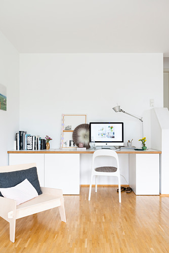 DIY work area made from kitchen base units and worksurface