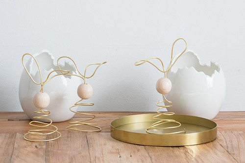 Easter bunnies made from golden wire and wooden beads