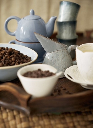 Coffee beans with a cup and a jug