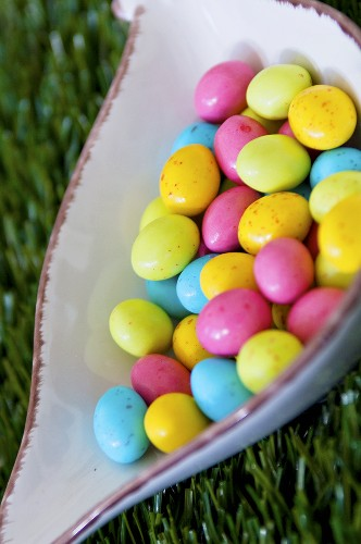 Coloured sugar eggs in a dish