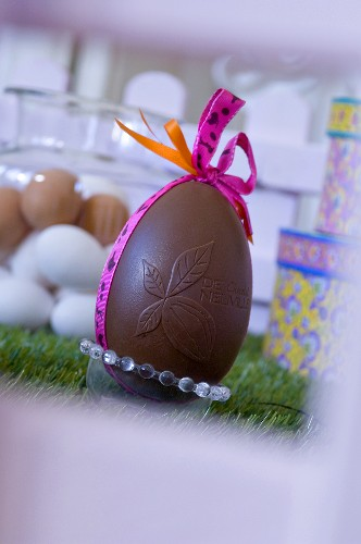 Chocolate Easter egg with gift ribbon