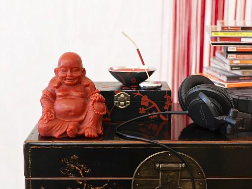 Buddha figure, music CDs and headphones
