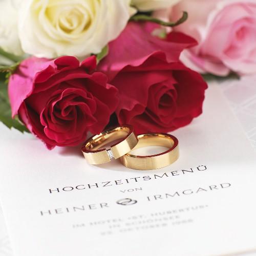 Wedding menu, wedding rings and roses