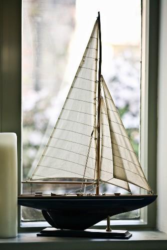 Model yacht by a window