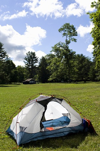 A Camping Tent Set up in a Field