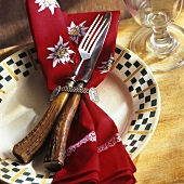 Cutlery with stag's horn handles on traditional fabric napkin