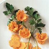 Carved carrot flowers with carrot leaves