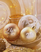Christmas baubles with the dates; 24th, 25th and 26th