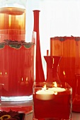 Red vases and floating candles (table or party decorations)