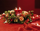 Advent arrangement: roses, gold threads & burning candles