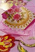 Home-made napkin holder with rose motif