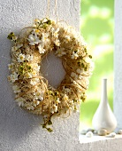 Door wreath with white fabric flowers