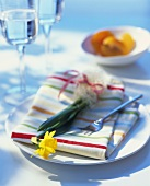 Spring place setting with fabric napkin and narcissus