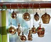 Silver Christmas tree ornaments as window decoration
