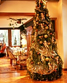 Christmas tree lavishly decorated with angels in traditional restaurant