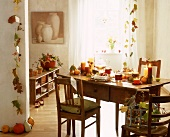 Interior with autumnal decoration on wooden table