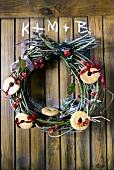 Door wreath with biscuits for Twelfth Night