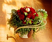 Christmassy bouquet with red roses and fir cones