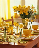 Easter table laid in yellow with daffodils