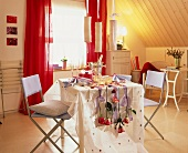 Romantic table for two with champagne and roses