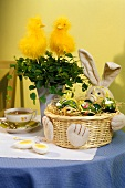 Easter basket with coloured eggs as table decoration
