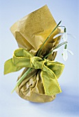 Small bag with green bow and snowdrops