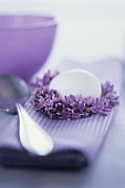 Purple fabric napkin with lilac wreath and white egg
