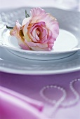 Rose on a plate as table decoration