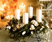 Advent wreath with white candles and white decoration