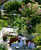 Lounger on idyllic terrace by garden pond