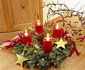 Advent wreath with four burning red candles