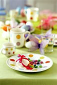 Colourful Easter table with chocolate beans