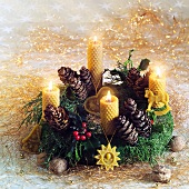 Advent wreath with fir cones and beeswax candles