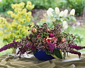 Unusual arrangement of lilac and roses